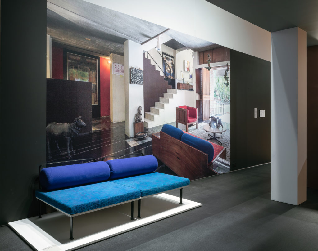 installation view of a blue couch and a wall mural with the couch in situ