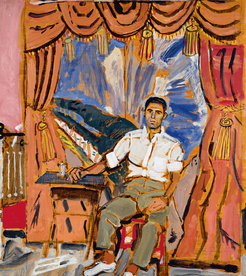 A man sitting infront of a stage set